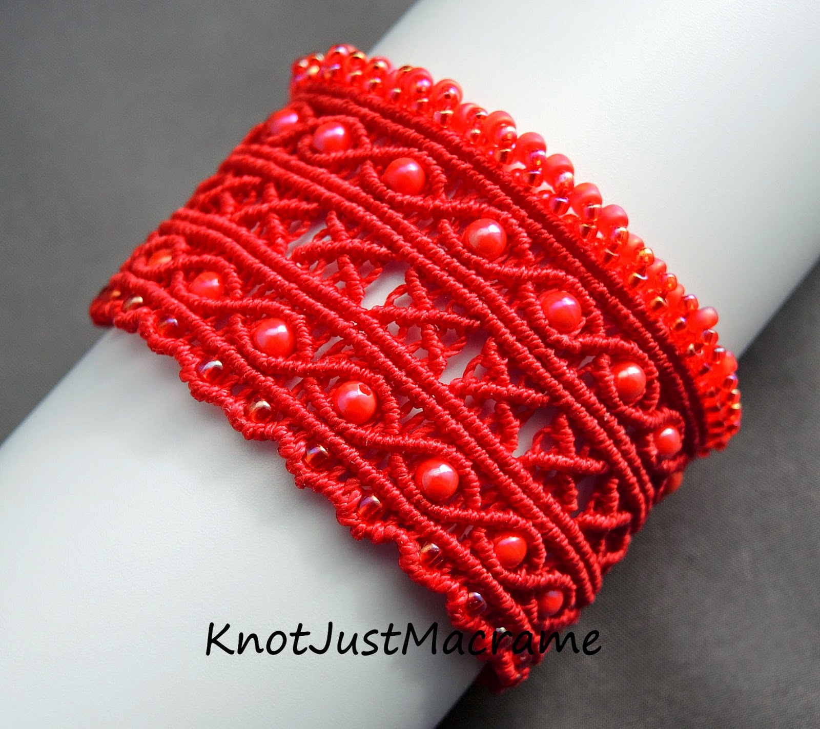 Argus micro macrame cuff in red by Sherri Stokey