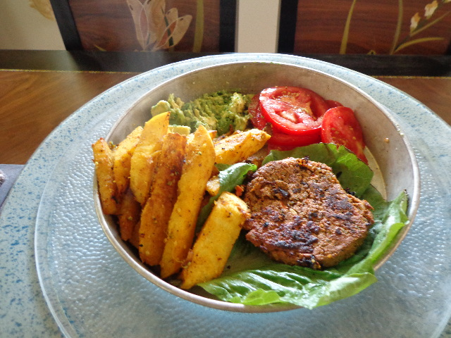 sprouted raw vegan black bean burgers with jicama fries, avocado and tomatoes