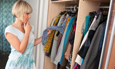 15 Ways to Choose Quality Over Quantity - woman girl choose clothes pick up wear closet
