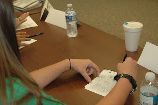 Student tries her hand at fingerprinting.