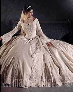 An old era, vintage, long sleeve lace ballgown wedding dress.