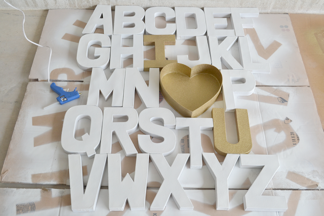once the hot glue dried i turned my alphabet over recruit help or it will be a mess and began to hot glue the letters together from the backside as well