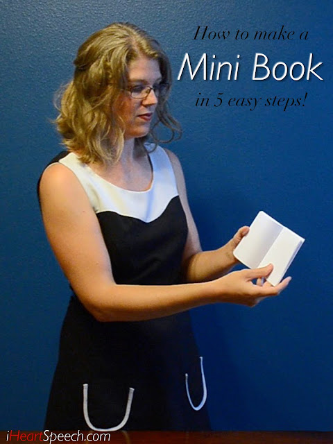 holding a mini book