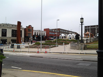 The completed Gardens, sculpture to the left, Barnsley Live gazebos being set up to the right and an old time carousel at the top.