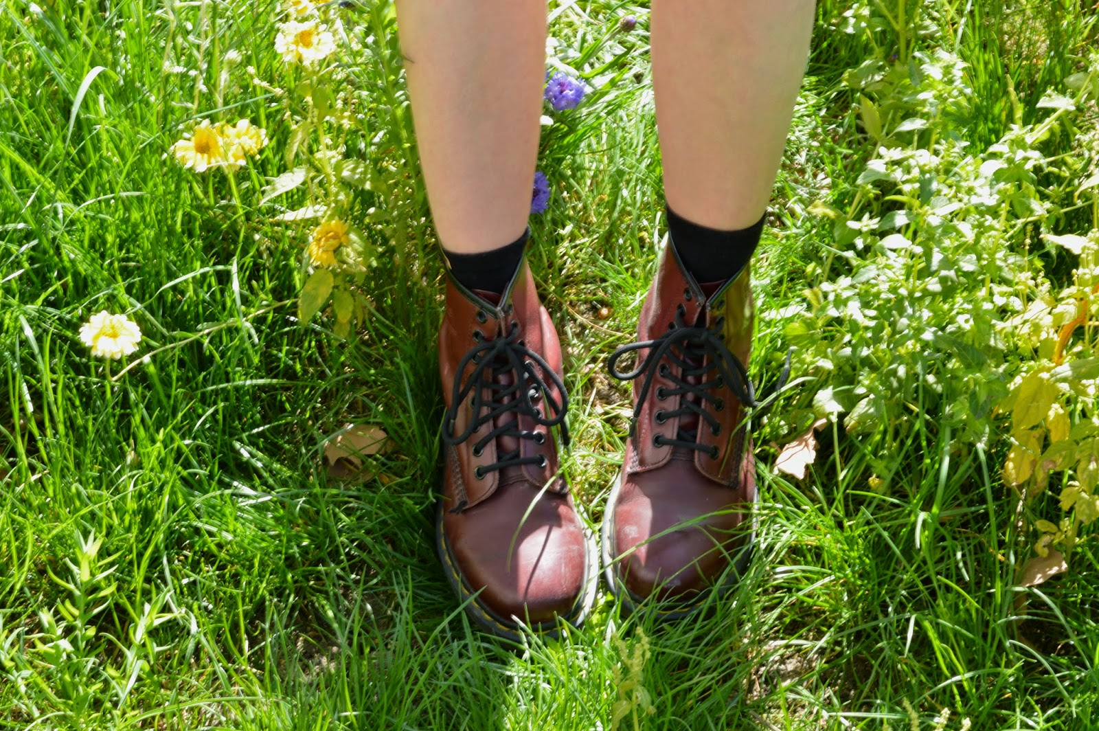 Grunge Dr Martens amongst grass and flowers