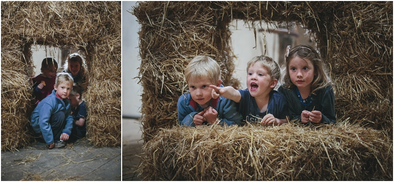 Children playing in a converted barn on a farm