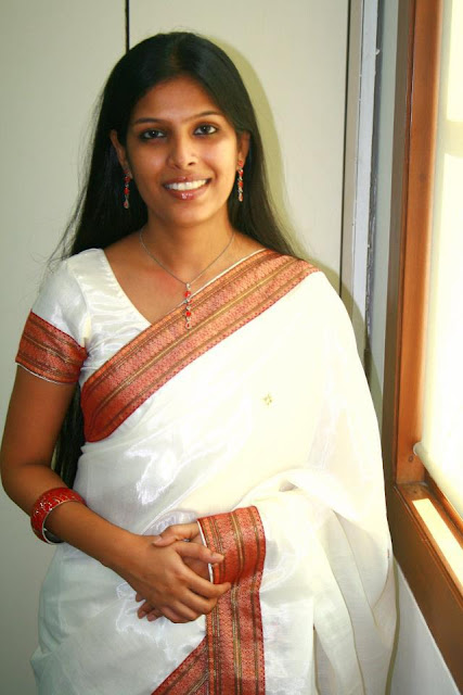 Kerala long hair girl in traditional white saree wear