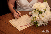 The decorative marriage document is signed by Megan