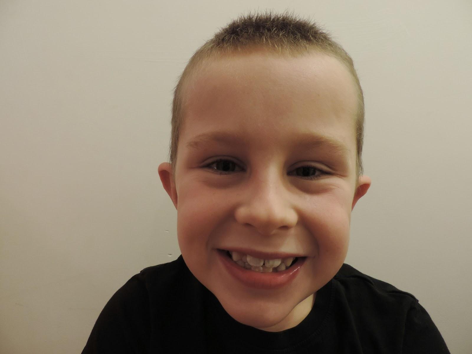 gurning boy smiling