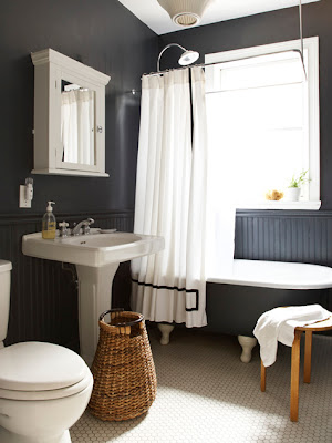 vintage clawfoot tub, black bathroom decor, wainscot