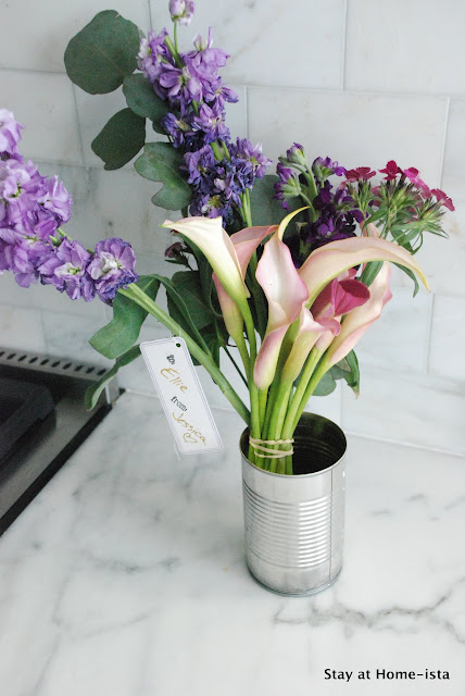 A quick and easy hostess gift or present, recuse a tin can as a vase.