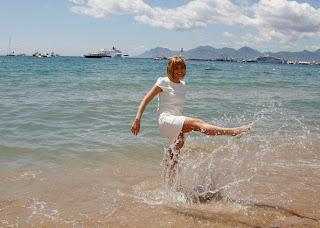 Jennifer Katharine Gates playing with water on beach
