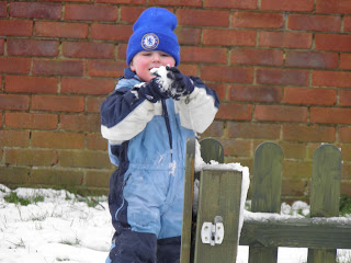 Isaac perfecting his snowball - Bournemouth Snow -January 2013