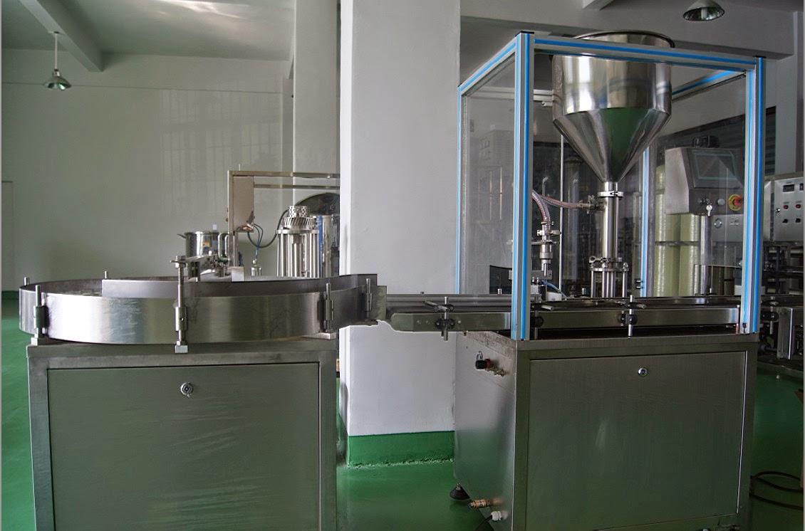 single head filling machine with bottles distributor Abfuellmaschine fuer Creme automatisch