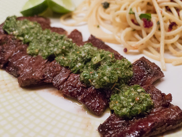 Churrasco skirt steak marinated, chimichurri, italian parsley oregano cilantro lime, red meat, argentinean steak
