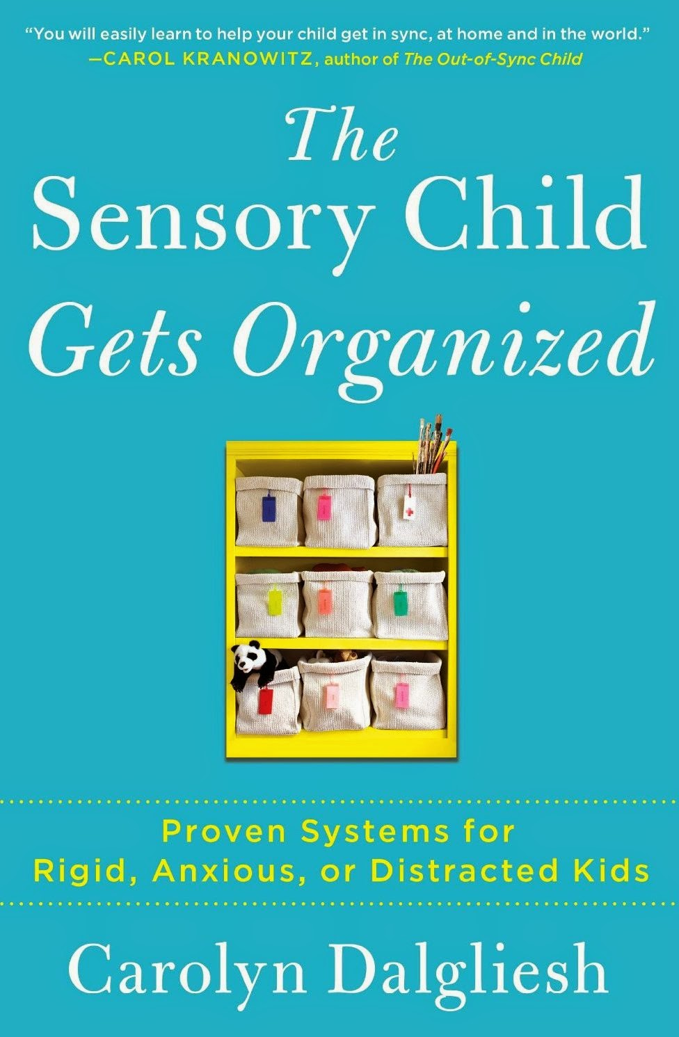 "Book cover: ""The Sensory Child Gets Organized, Proven Systems for Rigid, Anxious, or Distracted Kids"" by Carolyn Dalgliesh. Against a blue background, a child's possessions are arranged in storage containers on a yellow bookshelf."