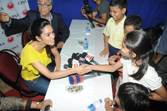 mallika sherawat visits cancer patients aid ociation. hot photoshoot