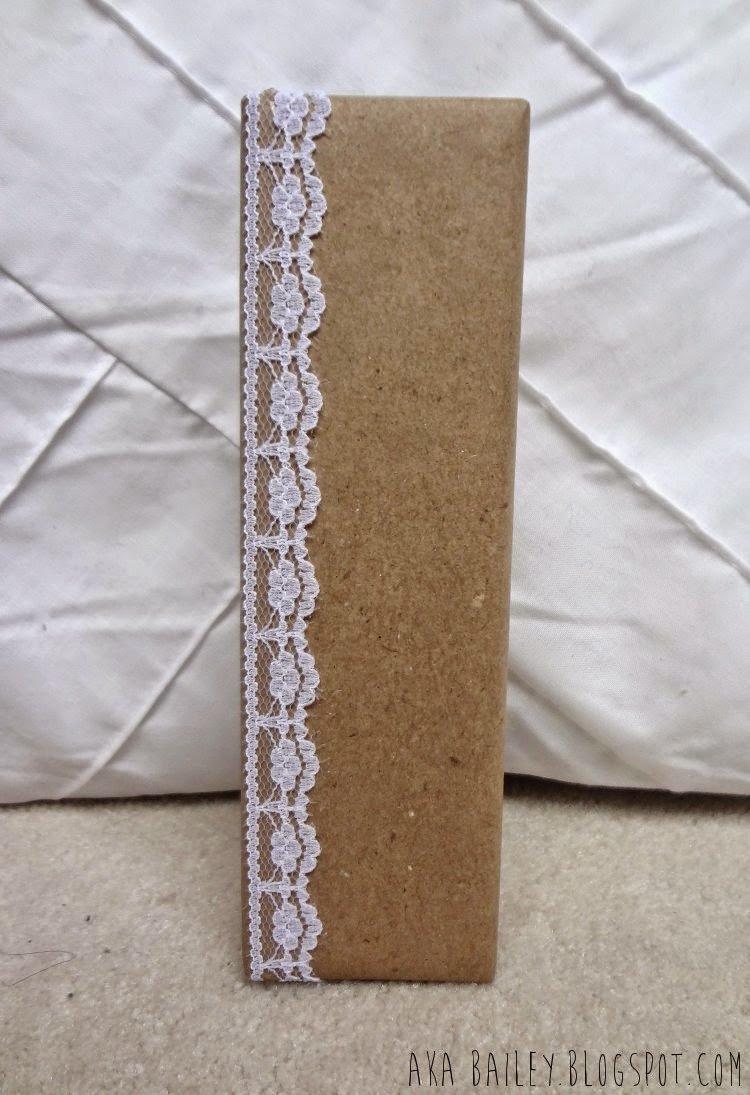 Brown paper gift wrap with lace trim