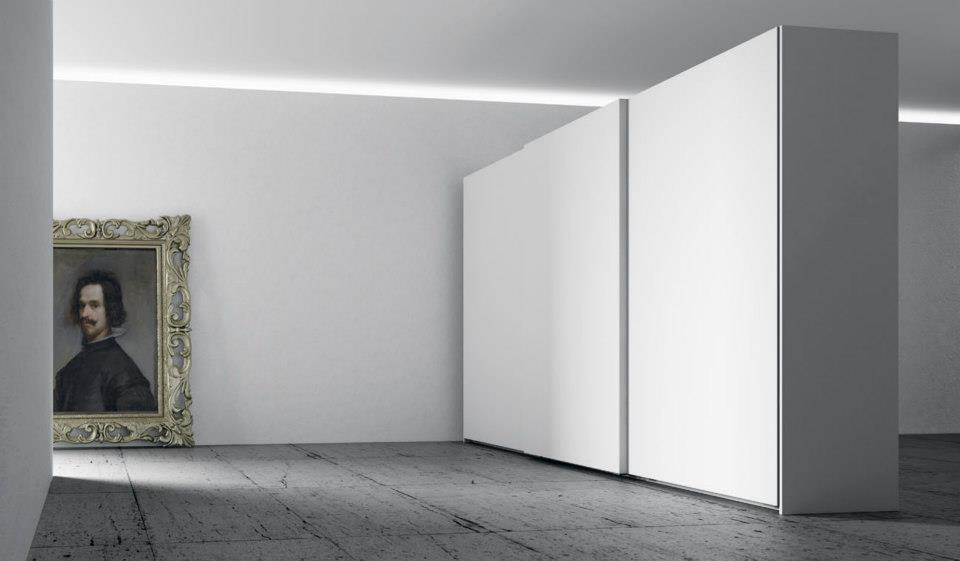 Armarios a medida especiales for Armarios empotrados puertas correderas blanco