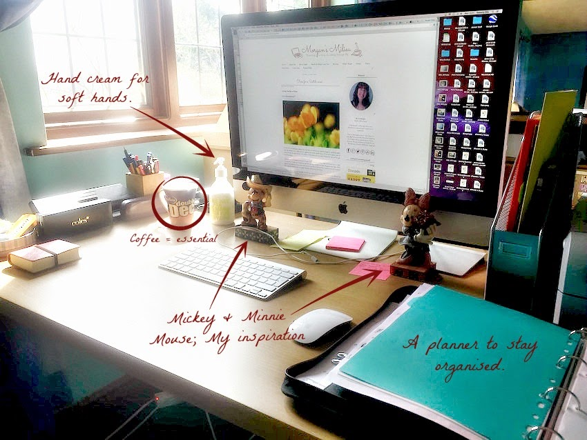 Morgan's Milieu   Pen Heaven Competition: My Workstation Photo Entry - An iMac sitting amongst office supplies on a beech desk.