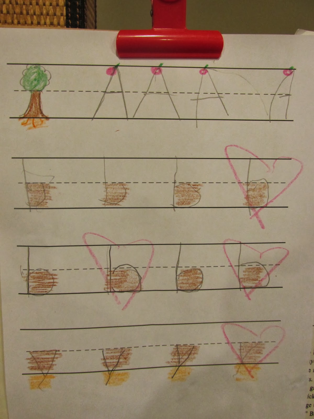Example of using tree template in teaching preschooler how to write letters