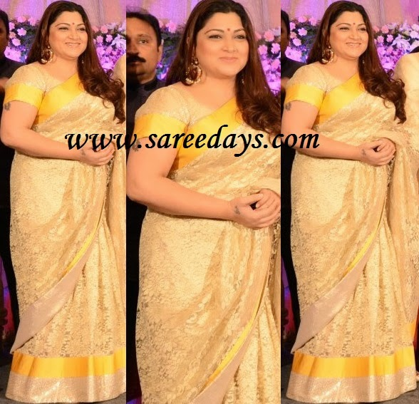 Latest saree designs kushboo in beige lacework designer saree checkout south indian actress kushboo in beige lacework designer saree with yellow and beige shimmer border and paired with matching short sleeves blouse altavistaventures Image collections