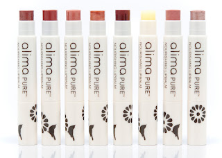 A row of 8 lipsticks in shades from sheer to dark red. Tall, slim white plastic tubes.