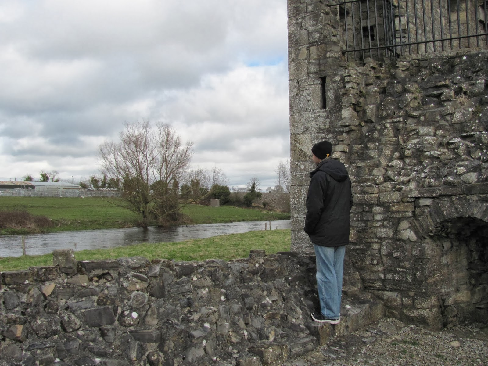Cory looks at the River Boyne at the Hospital of St. John the Baptist in Trim, Ireland