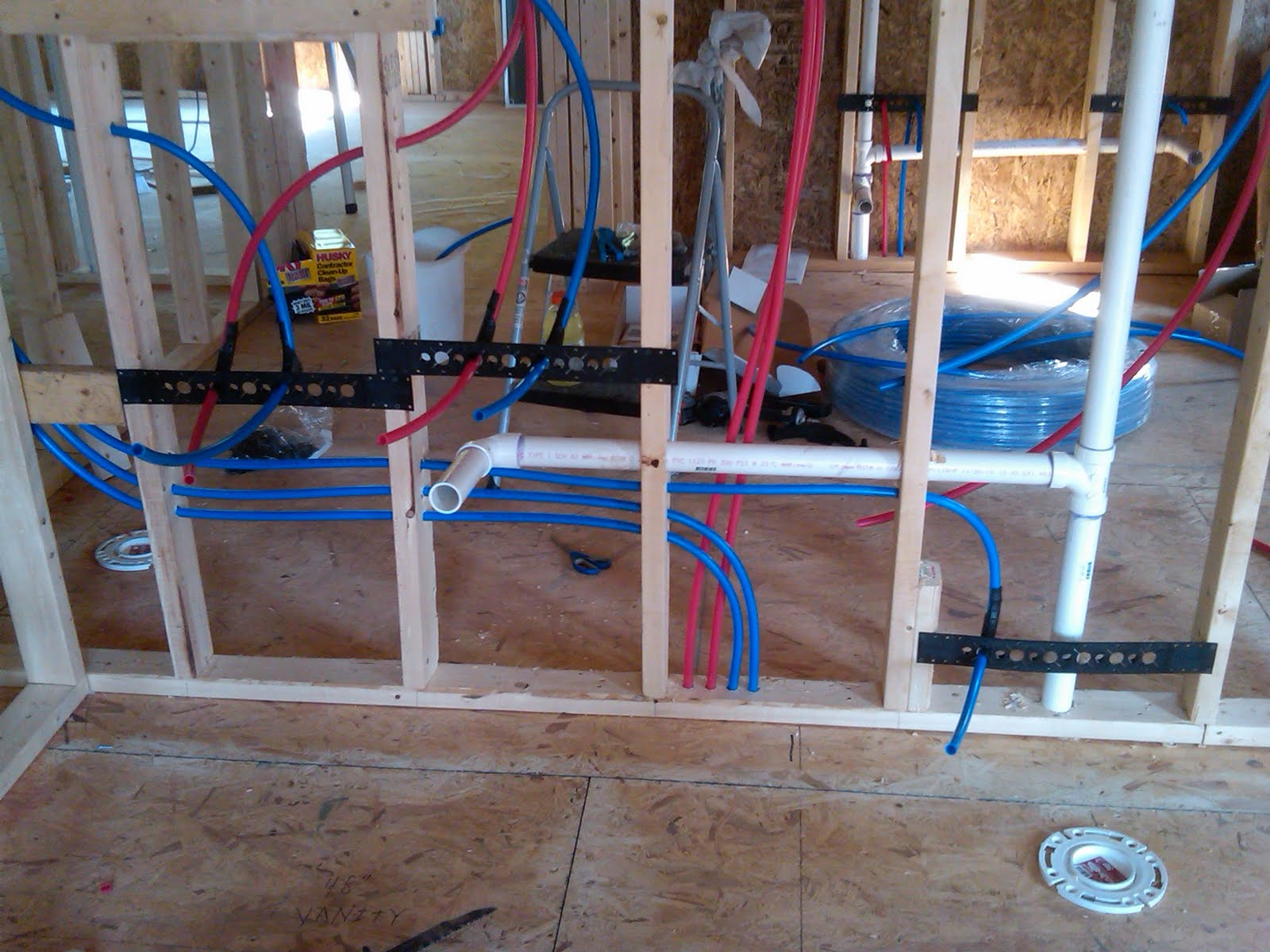 Not quite a teardown plumbing progress pex bathroom for Rough in plumbing for toilet