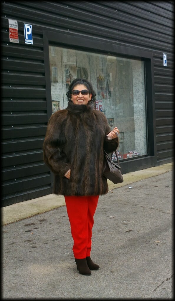 fur coat whit red pants