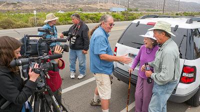 Gene Stone greets Lynn Harris Hicks.
