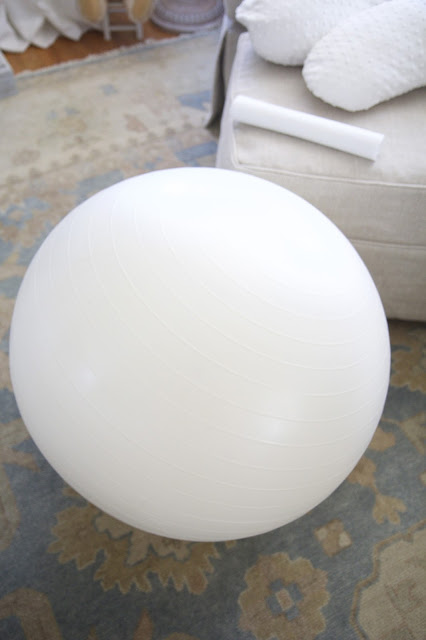 White Resist-a-Ball yoga ball; Baby Tools in the Nest; Nora's Nest