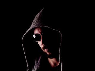 An older hooded gang member.