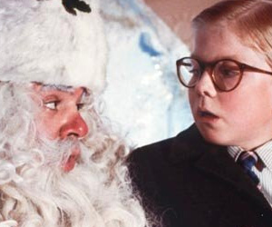 Ralphie and Santa Claus in A Christmas Story 1983 movieloversreviews.blogspot.com
