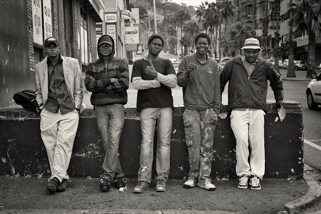 5 men pose for a street photograph in Cape Town South Africa.