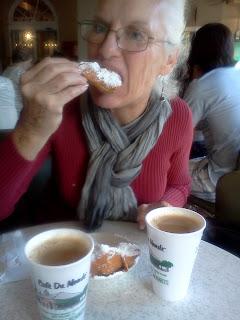 Joan enjoying beignets at