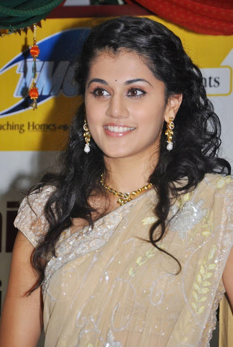 tapsee in saree at tmc electronics