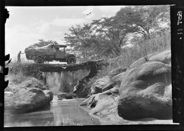 Crossing a river by bridge,  Mbeya, Tanganyika Territory, 1928. E.O. Teale Collection
