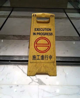 http://www.funnysigns.net/execution-in-progress/