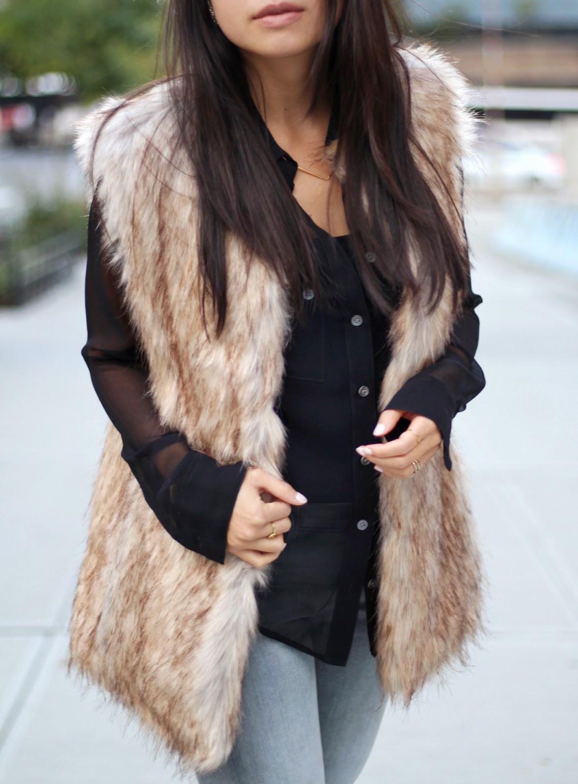 Zara fur vest Equipment black blouse J Brand midrise rail jeans Tibi mules