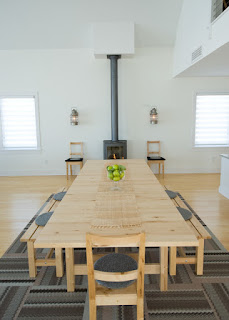 Minimalist Wooden Dining Sets With Benches on the Grey Carpet near the Grey Fireplace on Wooden Floor