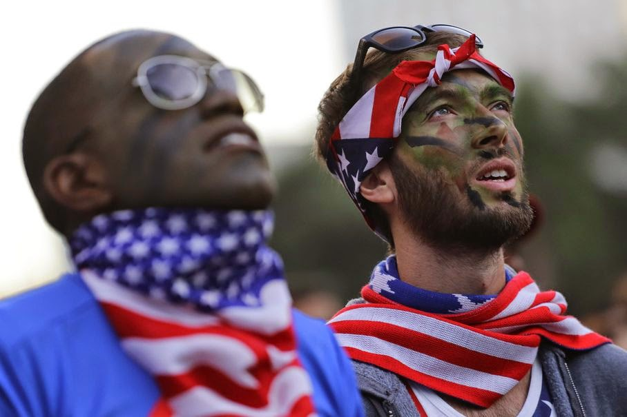 United States soccer fans with camouflage on thier faces watch the World Cup round of 16 match between Belgium and United States inside the FIFA Fan Fest area during the 2014 soccer World Cup in Sao Paulo, Brazil, Tuesday, July 1, 2014. Belgium beat the United States 2-1 in extra time to reach World Cup quarterfinals.