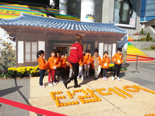 Kids at the persimmon festival at Seoul