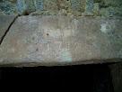 Llinda de la porta d'entrada al primer Molí del Pla, gravada amb la data de 1732