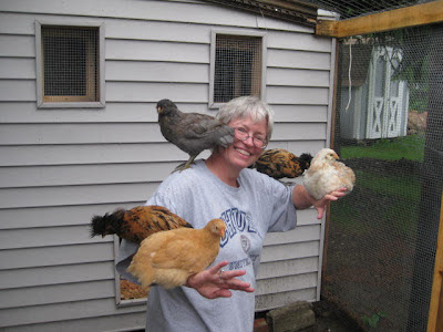 Woman with chickens perched on her arms and shoulders in Pittsburgh