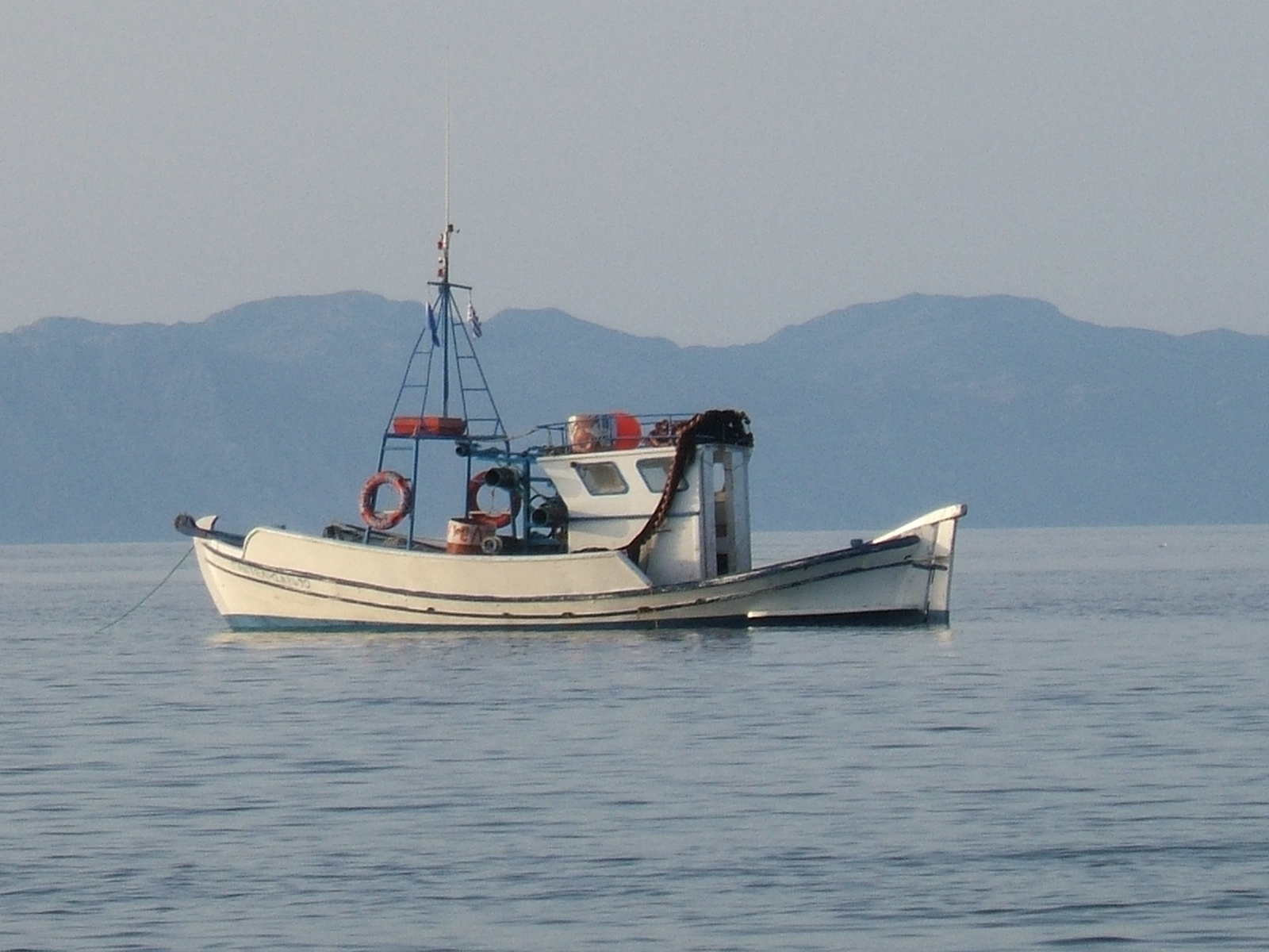 Fishing boat with Turkey in the distance, beautiful evening at Avra beach. Rhodes, Greece © 2008 Tina M Welter