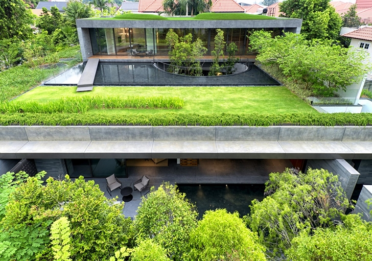 Green terraces and surrounding of The Wall House by FARM Architects