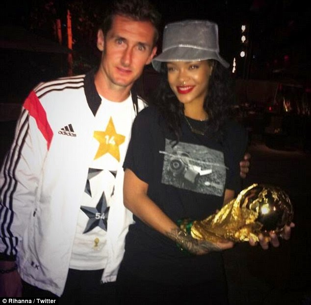 Rihanna posed up for pictures with various team members including 'King Klose'