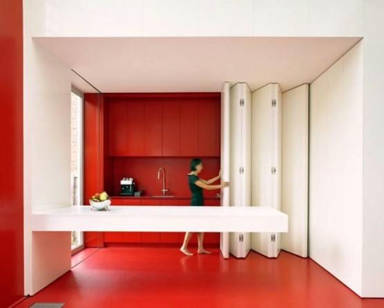 Una Proposta Salvaspazio Di DmvA Architecten: La Cucina Viene Completamente  Nascosta Dietro Un Sistema Di Pannelli Pieghevoli Che Formano Una Parete ...