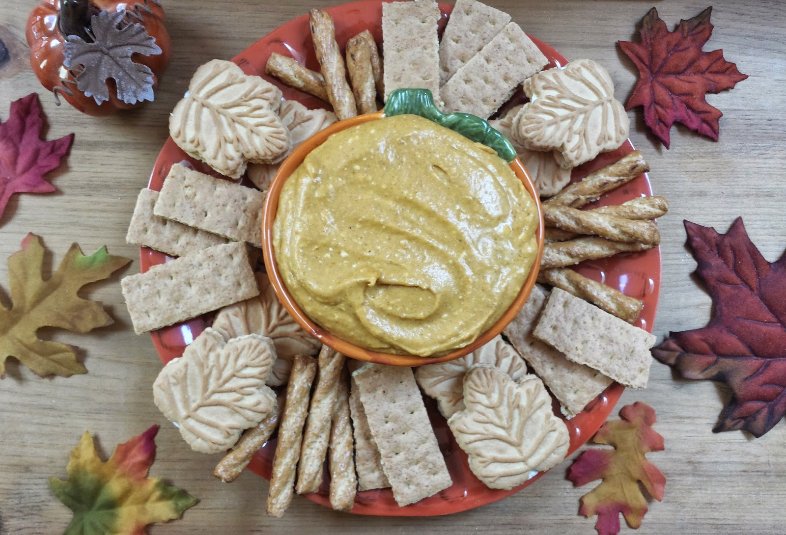 pumpkin pie dip on table with leaves